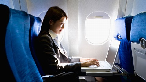 gty_woman_on_plane_window_Seat_thg_120425_wblog